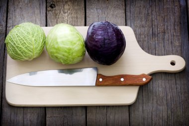 Cabbage and knife on cutting board preparation for cooking