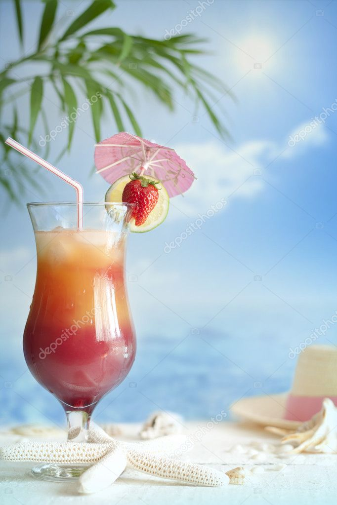 Cocktail on the beach with starfish blurred background concept