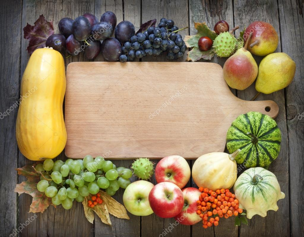 autumn fruits and vegetables and empty cutting board u2014 stock photo