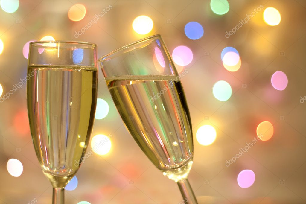 two glasses of champagne on blurred new year party background stock photo