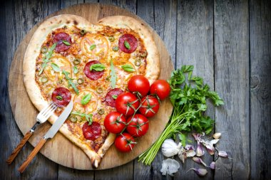 Pizza heart shape with cheese and tomato on vintage boards