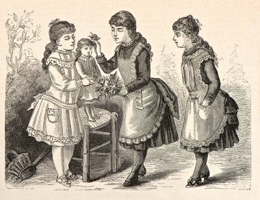 Three little girls playing with a doll