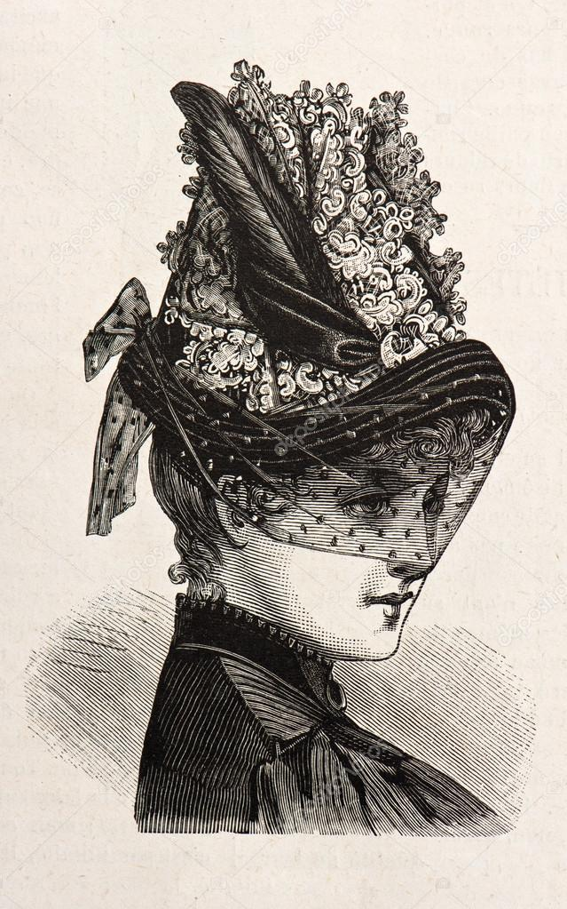 Young woman wearing an elegant hat