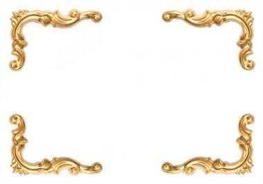 Golden elements of carved frame on white
