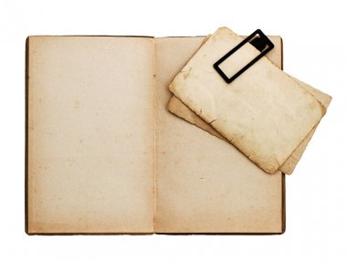 open old book with postcard isolated on white