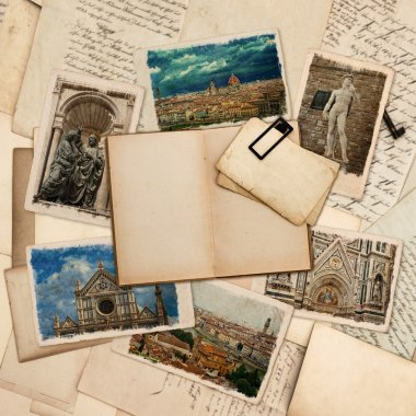 Open old book and postcards with pictures of florence