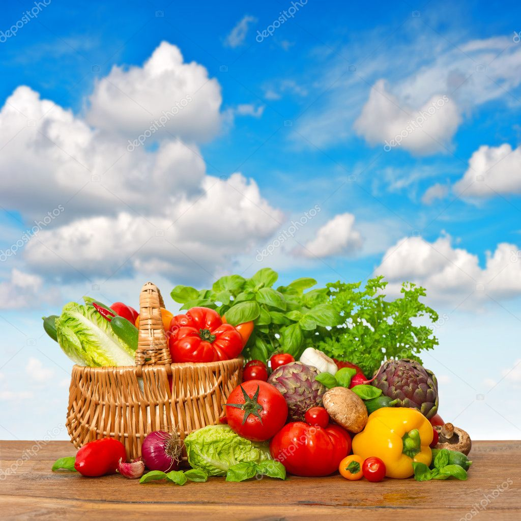Fresh vegetables and herbs with blue sky