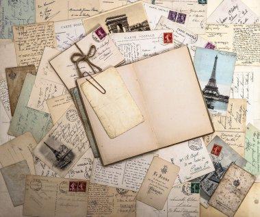 old postcards and open book. nostalgic vintage background