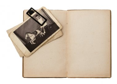 open old book with retro baby picture isolated on white
