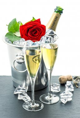 Champagne and red rose
