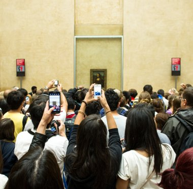 Visitors take photos of Mona Lisa