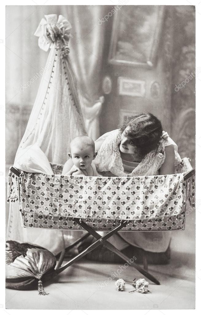 Antique family portrait of mother and baby