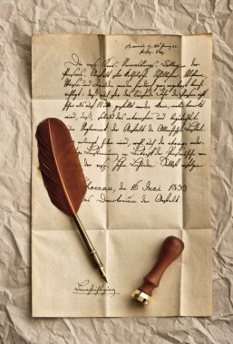 old letter with feather quill and wax seal