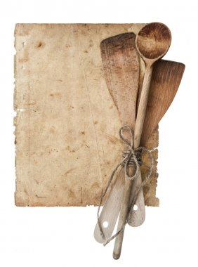 Retro kitchen utensils and old cook book page