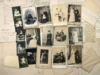 Old handwritten letters and antique family photos