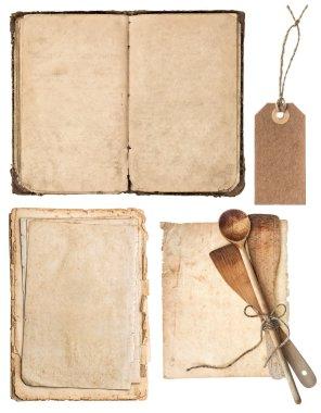 Vintage wooden kitchen utensils, old cookbook, pages
