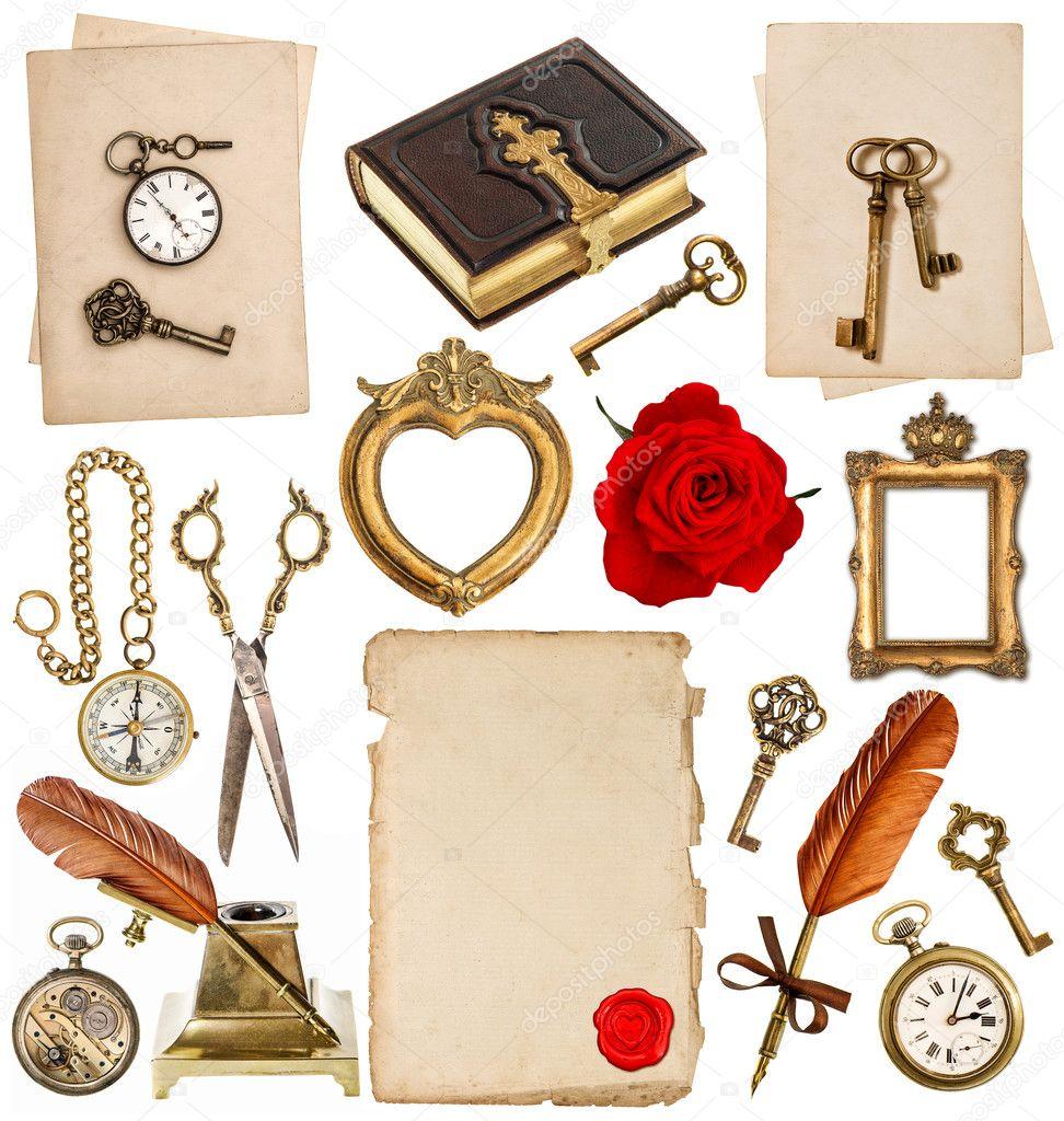 Antique clock, key, photo album, feather pen, inkwell, compass