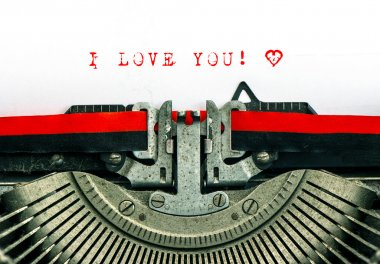 typewriter with sample text I LOVE YOU and heart