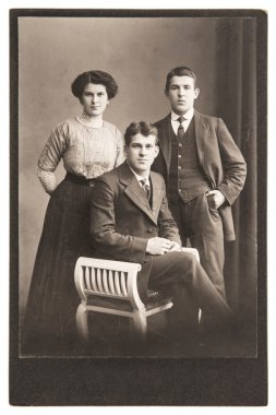 Antique portrait of young people wearing vintage clothing