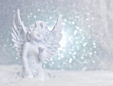 little white guardian angel in snow