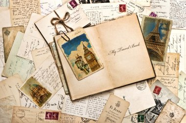 Old postcards, letters, mails and open travel book