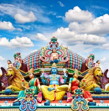 Oldest Hindu temple Sri Mariamman in Singapore over blue sky