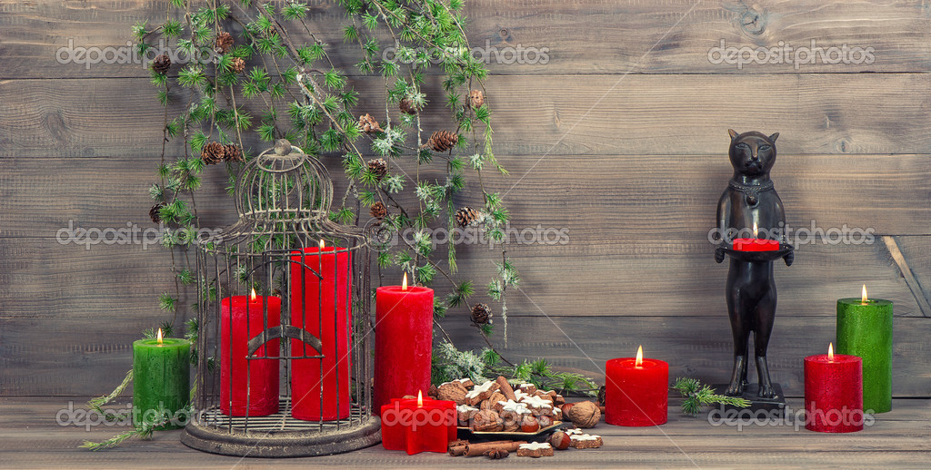 Christmas Decoration With Red Candles Birdcage And Pine Branche