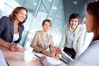 Image of successful females listening to colleague at meeting stock vector