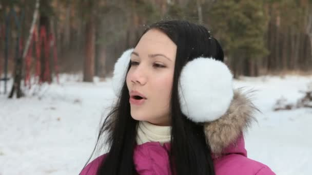 Girl breathing out in wintry air