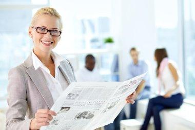 Female reading newspaper