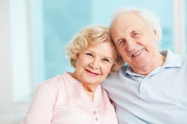 Portrait of a candid senior couple enjoying their retirement stock vector