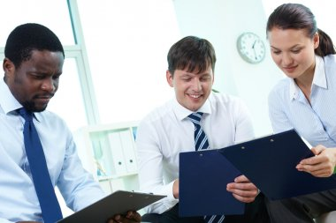 Business partners with clipboards