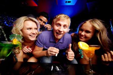 Friends in night club
