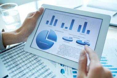 Close-up of a financial analyzer holding a digital tablet with statistical data stock vector