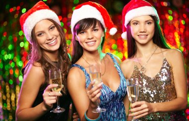Cheerful girls on Christmas party