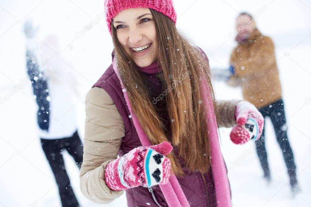 Happy girl in winterwear laughing