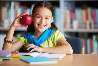 Schoolgirl with big red apple