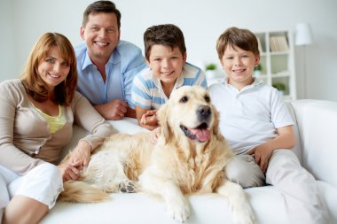 Family at home with dog