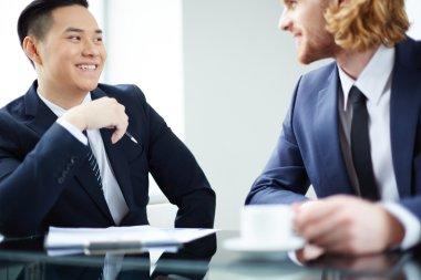 Entrepreneurs interacting at meeting