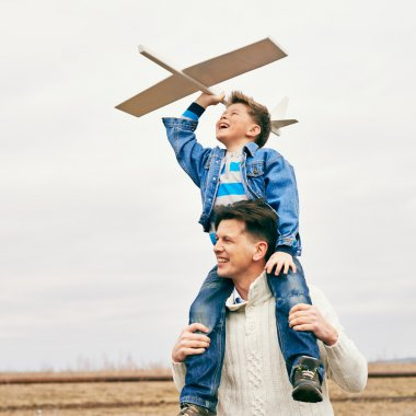 Father and son with toy airplane