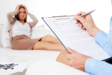 Psychiatrist consulting her patient