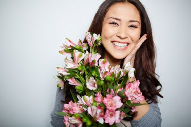 Satisfied woman with flowers