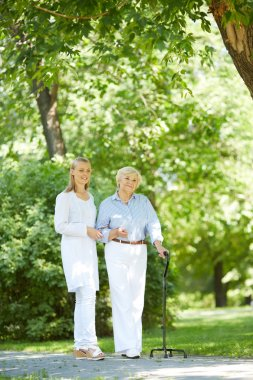 Nurse  walking with patient