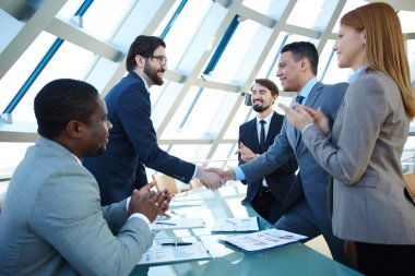 Business people congratulating their colleagues