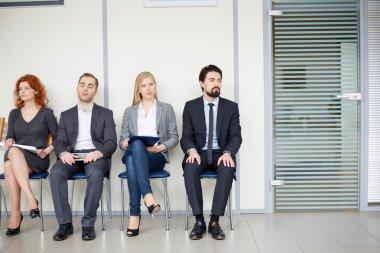 Business associates sitting by door