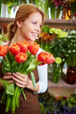 Florist with red tulips