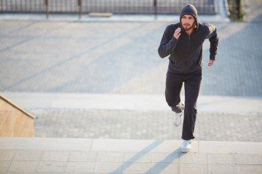 Sportsman running outside
