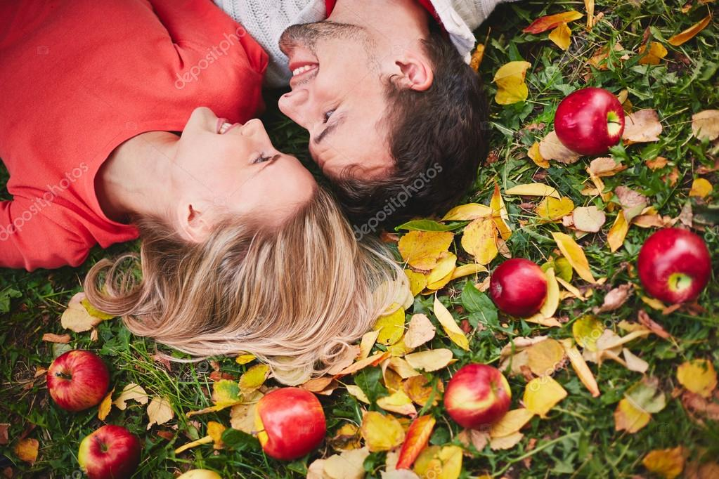 Couple with ripe apples