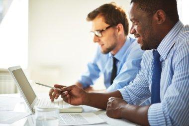 Businessmen using laptop