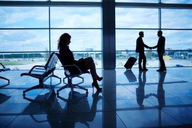 Businesswoman sitting in airport